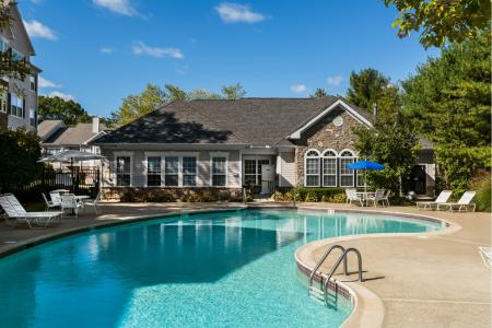 Swimming pool with large sundeck at River Pointe at Den Rock Park Apartments