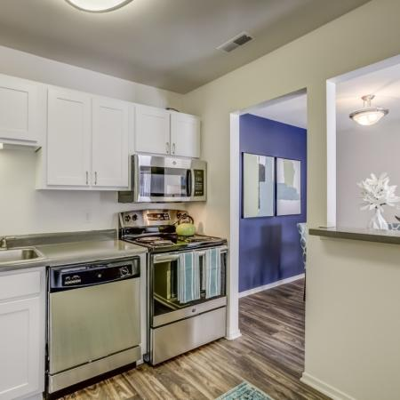 Silver appliances and beautiful white cabinets at Arbor Landings Apartment in Ann Arbor, MI