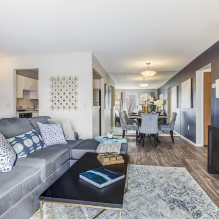 Open living room and dining room at Oaks at Hampton Apartments in Rochester Hills, MI