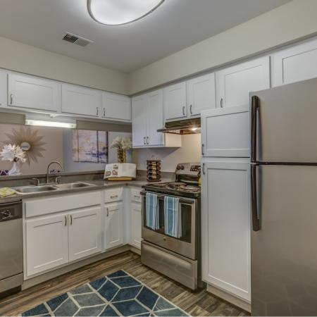 Kitchen with stainless steel appliances at Spring Valley Apartments in Farmington Hills, MI