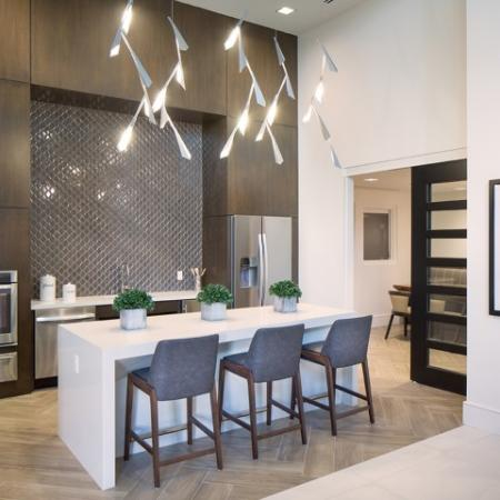 Social lounge kitchen at RIZE Irvine apartments in Irvine CA
