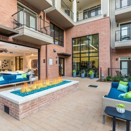 Outdoor fireplace at Inwood Station apartments in Dallas TX