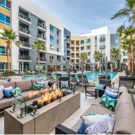 Poolside fire feature at RIZE Irvine apartments in Irvine, Ca
