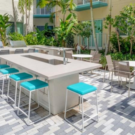 Pool side BBQ and lounge area ORA Flagler Village Apartments in Fort Lauderdale Florida