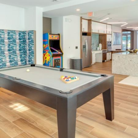 Pool table and arcade games in THE BUZZ ORA Flagler Village Apartments in Fort Lauderdale Florida