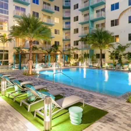 THE SUN - heated pool with seating area at ORA Flagler Village in Fort Lauderdale FL