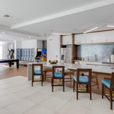 Clubhouse kitchen at ORA Flagler Village apartments in Fort Lauderdale, FL