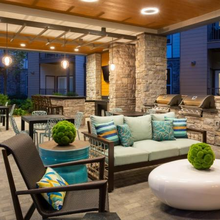 Outdoor lounge with grilling area at Mave Apartments in Stoneham, MA