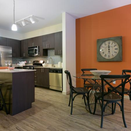 Beautiful wood-look flooring throughout the kitchen, living, and dining areas at 7001 Arlington Apartments in Bethesda, MD