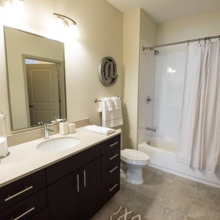 Spa-like bathrooms equiped with modern quartz countertops and vanities with ample storage