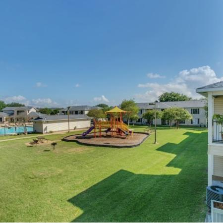 Pool and tot lot at Paradise Oaks Apartments in Austin TX
