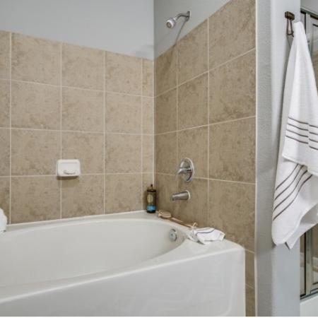 Separate shower at Montfair at the Woodlands apartments in Houston TX