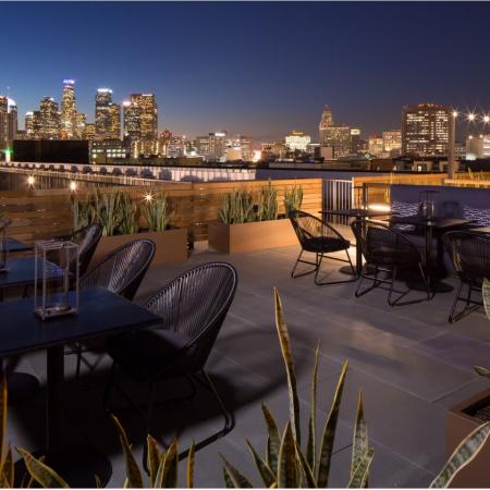 Rooftop lounge seating area at night at Aliso Apartments in Los Angeles CA
