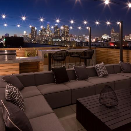 Rooftop lounge television seating area at Aliso Apartments in Los Angeles CA