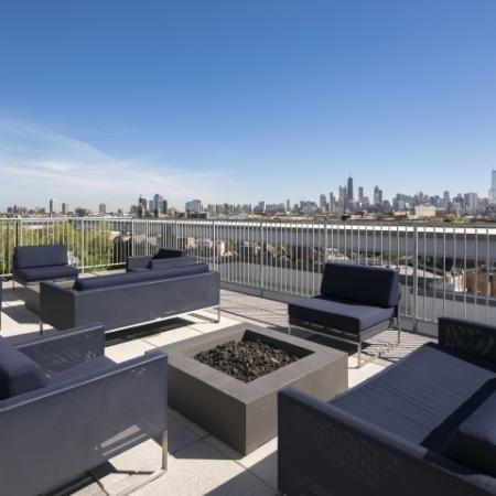 Rooftop deck with fire pit and skyline views.