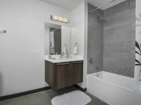 Bathroom featuring quartz countertops.