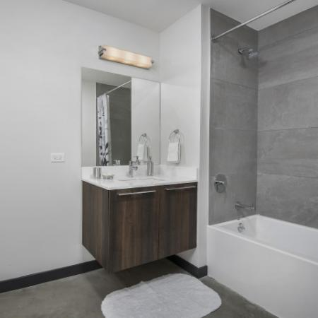 Bathroom featuring quartz countertops.