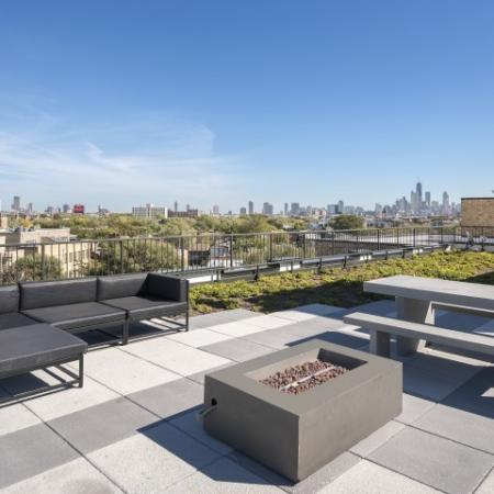 Rooftop terrace with fire pit and skyline views.