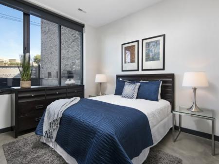 Bedroom with roller shades.