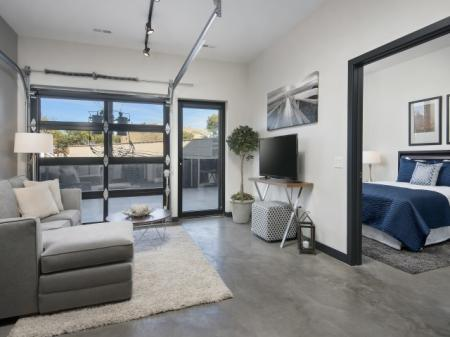 Living room with access to spacious terrace.
