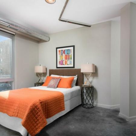 Bedroom with floor to ceiling windows.