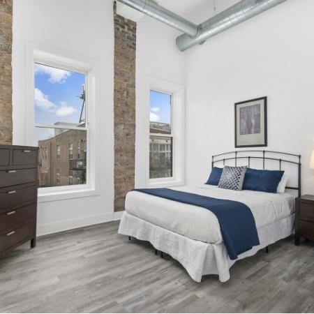 High ceilings and exposed brick in 2 bedroom