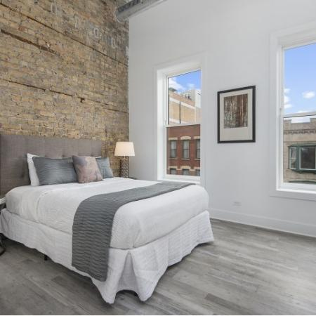 Bedroom with exposed brick