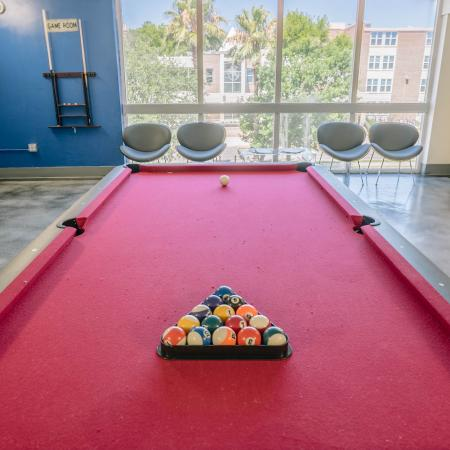 The Renegade, interior, game room, blue wall, large windows, red billiard table