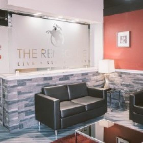 The Renegade, interior, main lobby, property sign, blue and orange walls, black leather seating