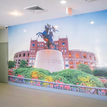 """The Osceola, interior, large wall photo, brick building, statue, """"Unconquered"""", flowers"""
