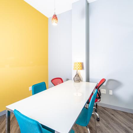The Osceola, interior, conference room, blue and red chairs, yellow wall,