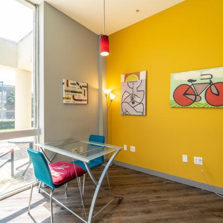 The Osceola, interior, conference room, blue and red chairs, yellow wall, windows to outdoor lounging