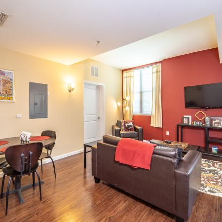 The Osceola, interior, dining/living room, wood floor, red accent wall,