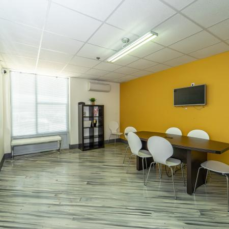 The Renegade, interior, conference room, wood floor, natural light, windows, yellow wall