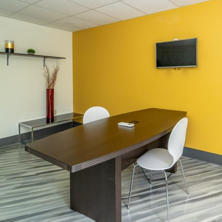 The Renegade, interior, conference room, wood floor, natural light, yellow wall
