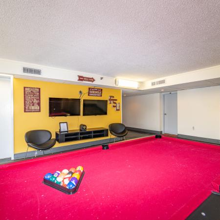 The Renegade, interior, game room, blue wall, red billiard table, tvs
