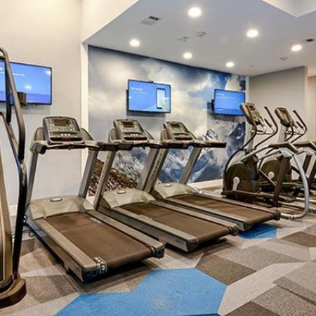 Gym with stair climber, 3 treadmills, and 2 elliptical