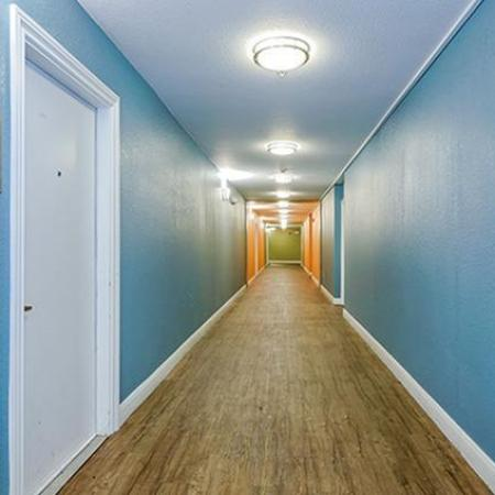 Apartment hallways with LVT flooring and blue walls