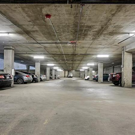 Parking garage with overhead sprinklers and lighting