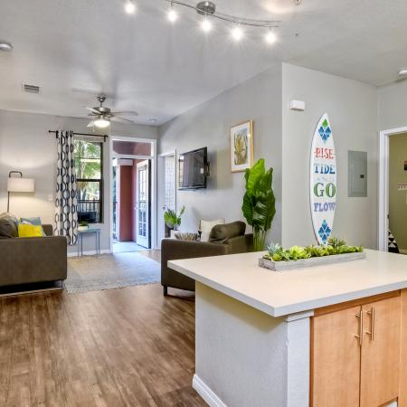 Model Apartment kitchen looking towards the living room from above the kitchen island