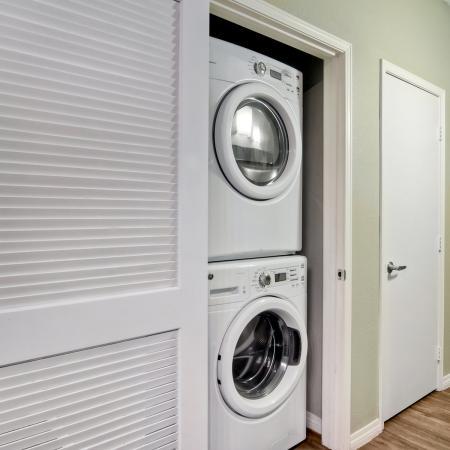 Model apartment with stacked washer and dryer closet