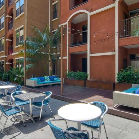 Outdoor courtyard chairs, tables, outdoor couches, and market lights