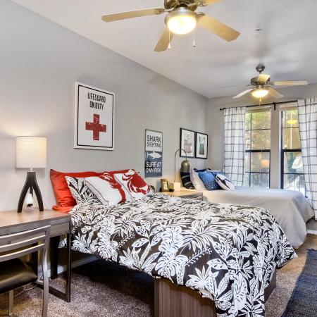 Model apartment bedroom showing double occupancy option with two beds and desks