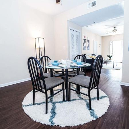 The Osceola, interior, dining room, table for four, wood floors white walls