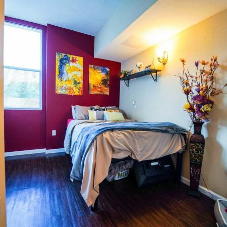The Osceola, interior, bedroom, fuchsia accent wall, bed, wood floor