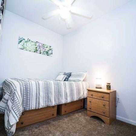 The Osceola, interior, bedroom, carpet, bed with drawers beneath, ceiling fan