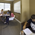 Five students using the study room at The Reserve on West 31st