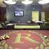 Pool table, flat screen TV and seating area in the game room at The Reserve on West 31st