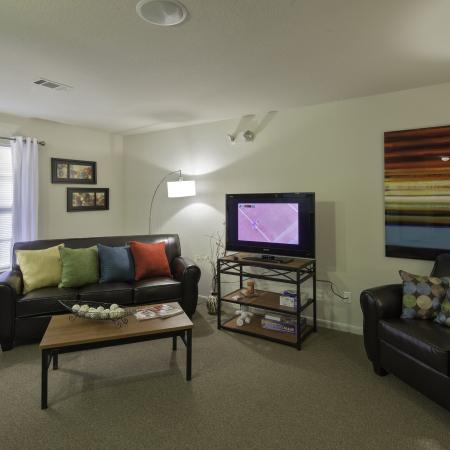 Cayce Cove living room with a couch, chair, end tables, and flat screen TV