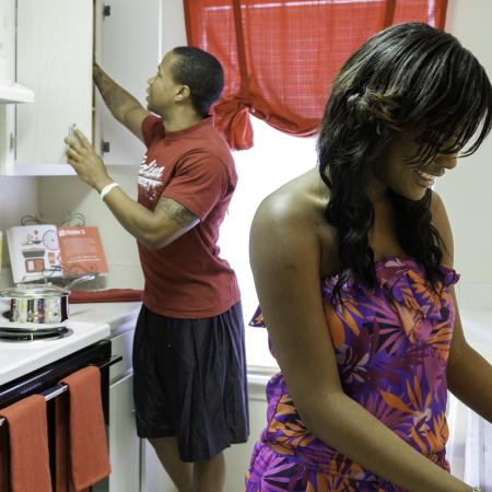 A man and a woman standing in a kitchen at Cayce Cove